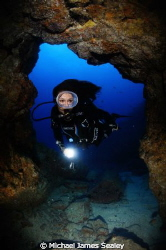 The undrwater model Belen Caro entering a cave in Tenerife by Michael James Sealey 
